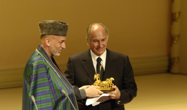 "From the Ismailimail archives. Berlin, Germany, 3 October 2005: President Hamid Karzai of the Islamic Republic of Afghanistan presents the ""United we Care"" award to His Highness Prince Karim Aga Khan. The Die Quadriga awards are presented every year on the day of German Unification. (Image credit: AKDN/Gary Otte)"