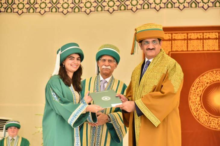 Sindh Chief Minister Syed Murad Ali Shah (right), was the chief guest at the Aga Khan University (AKU) 29th convocation. Pictured here is Sind Minister Murad with AKU President, Firoz Rasul (center) and a smiling and proud graduate (left). (image credit AKU).