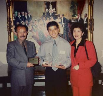 Proud parents Burhan and Fawzia with Zardasht upon him having won two I-STAR Awards in 2002 in Toronto.