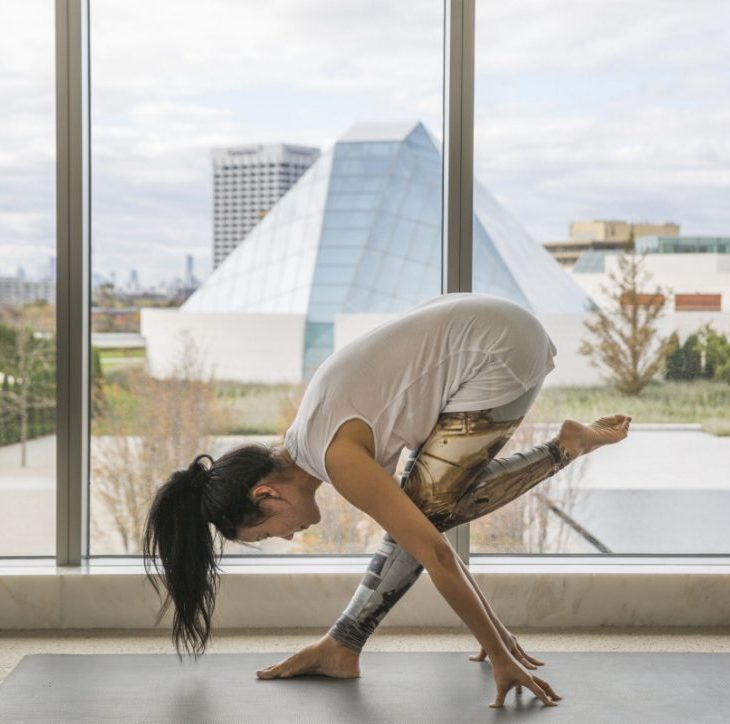 Yoga instructor YuMee Chung demonstrates a daring Pyramid Pose at the Aga Khan Museum, with the Ismaili Centre, Toronto in the background. (Image credit: Anne-Marie Jackson)