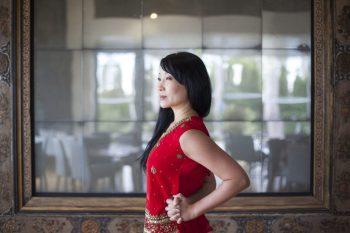 Yoga instructor YuMee Chung demonstrates a posture perfecting pose called Elbow Room at the Syrian inspired Diwan restaurant of the Aga Khan Museum overlooking the Ismaili Centre, Toronto. (Image credit: Anne-Marie Jackson via Toronto Star)
