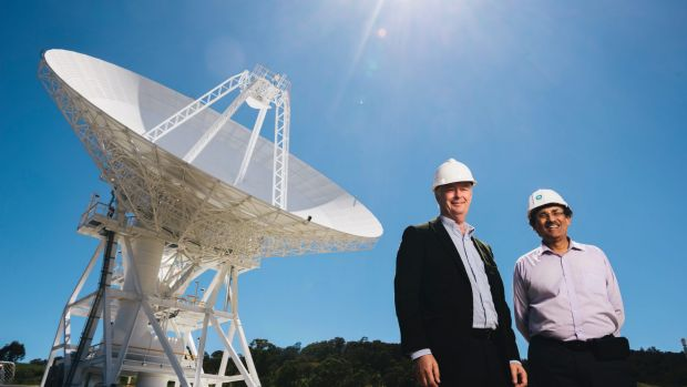 Station Director Ed Kruzins and Network Director Al Bhanji with Deep Space Station 36, the new antenna set to be officially opened on Thursday. Photo: Rohan Thomson