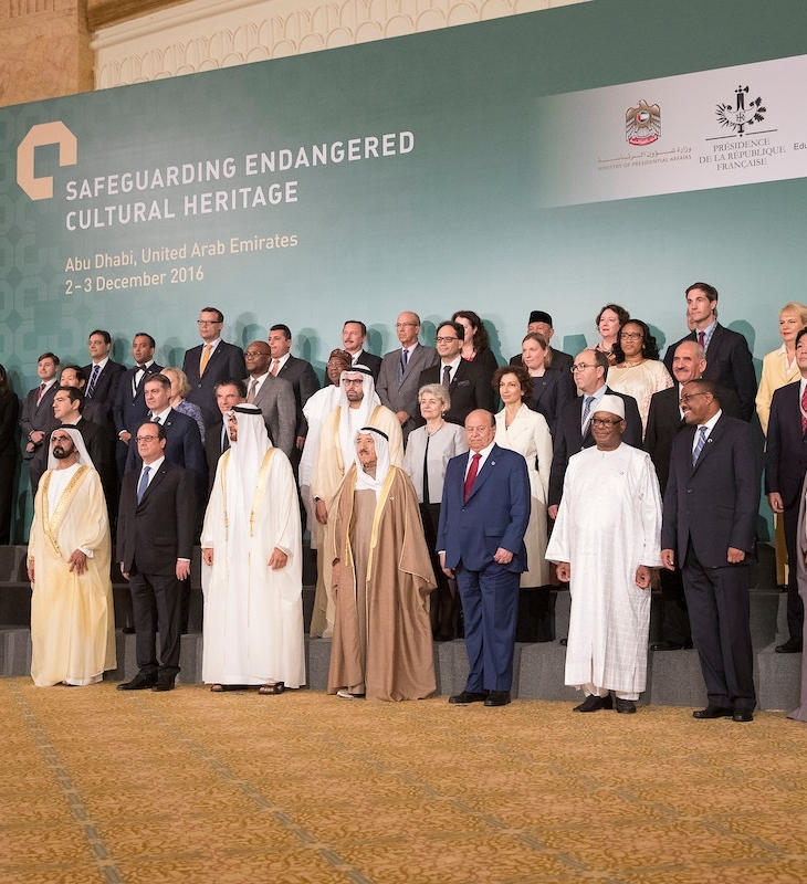 ABU DHABI, UNITED ARAB EMIRATES - December 03, 2016: (front row L-R) HH Prince Aga Khan IV, HH Sheikh Jassim bin Hamad Al Thani Personal Representative of the Emir Qatar, HRH Prince Khalid al Faisal Advisor to the Custodian of the Two Holy Mosques and Governor of Makkah Region, HE Ashraf Ghani President of the Islamic Republic of Afghanistan, HH Sheikh Mohamed bin Rashid Al Maktoum, Vice-President, Prime Minister of the UAE, Ruler of Dubai and Minister of Defence, HE Francois Hollande, President of France, HH Sheikh Mohamed bin Zayed Al Nahyan, Crown Prince of Abu Dhabi and Deputy Supreme Commander of the UAE Armed Forces, HH Sheikh Sabah Al Ahmad Al Jaber Al Sabah Emir of Kuwait, HE Abdrabbuh Mansour, Hadi President of Yemen, HE Ibrahim Boubacar Keita, President of Mali, HE Hailemariam Desalegn Prime Minister of Ethiopia, HH Sheikh Nasser bin Hamad bin Isa Al Khalifa, HE Yusuf bin Alawi bin Abdullah Foreign Minister of Oman (R), (2nd row) HE Alexis Tsipras, Prime Minister of Greece (3rd L), HE Denis Zvizdic, Chairman of the Council of Ministers of Bosnia and Herzegovina (4th L), HE Jack Lang President of Institut du Monde Arabe (5th L), HE Mohamed Khalifa Al Mubarak Chairman of Abu Dhabi Tourism & Culture Authority (6th L), HE Irina Bokova Director General of UNESCO (7th L) and other dignitaries, stand for a photograph during the Safeguarding Endangered Cultural Heritage Conference at Emirates Palace. (Image credit: PRNewsFoto/Abu Dhabi Tourism & Culture Auth)