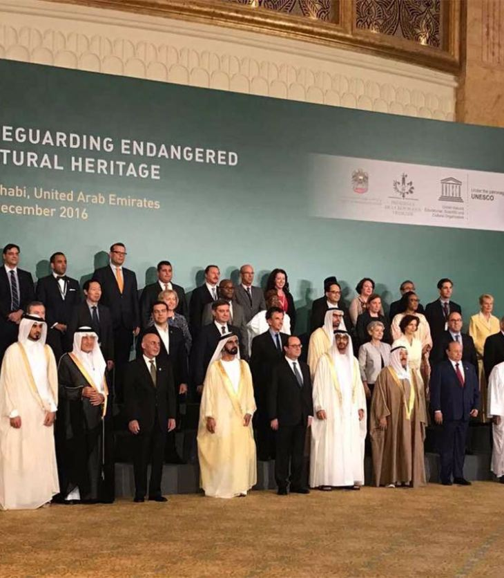 ABU DHABI, UNITED ARAB EMIRATES – December 03, 2016: (front row L-R) HH Prince Karim Aga Khan IV, HH Sheikh Jassim bin Hamad Al Thani Personal Representative of the Emir Qatar, HRH Prince Khalid al Faisal Advisor to the Custodian of the Two Holy Mosques and Governor of Makkah Region, HE Ashraf Ghani President of the Islamic Republic of Afghanistan, HH Sheikh Mohamed bin Rashid Al Maktoum, Vice-President, Prime Minister of the UAE, Ruler of Dubai and Minister of Defence, HE Francois Hollande, President of France, HH Sheikh Mohamed bin Zayed Al Nahyan, Crown Prince of Abu Dhabi and Deputy Supreme Commander of the UAE Armed Forces, HH Sheikh Sabah Al Ahmad Al Jaber Al Sabah Emir of Kuwait, HE Abdrabbuh Mansour, Hadi President of Yemen, HE Ibrahim Boubacar Keita, President of Mali, HE Hailemariam Desalegn Prime Minister of Ethiopia, HH Sheikh Nasser bin Hamad bin Isa Al Khalifa, HE Yusuf bin Alawi bin Abdullah Foreign Minister of Oman (R), (2nd row) HE Alexis Tsipras, Prime Minister of Greece (3rd L), HE Denis Zvizdic, Chairman of the Council of Ministers of Bosnia and Herzegovina (4th L), HE Jack Lang President of Institut du Monde Arabe (5th L), HE Mohamed Khalifa Al Mubarak Chairman of Abu Dhabi Tourism & Culture Authority (6th L), HE Irina Bokova Director General of UNESCO (7th L) and other dignitaries from over 40 countries, stand for a photograph during the Safeguarding Endangered Cultural Heritage Conference at Emirates Palace. (Image via Ismaili.net)
