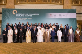 His Highness Prince Karim Aga Khan (1st down left) and French President Francois Hollande (6th down left), pose for a photo between Sheikh Mohammed bin Zayed al-Nahyan, Crown Prince of Abu Dhabi and UAE's deputy commander-in-chief of the armed forces, on his right, and Sheikh Mohammed bin Rashid al-Maktoum, UAE prime minister and ruler of Dubai with the other head of states and dignitaries during the Safeguarding Endangered Cultural Heritage Conference at Emirates Palace in Abu Dhabi, United Arab Emirates. (Image credit: Emirates News Agency via AP)