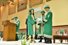 Dean Medical College AKU Dr Farhat Abbas awarding a student at AKU's 21st PGME graduation ceremony-2