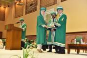 Dean Medical College AKU Dr Farhat Abbas awarding a student at AKU's 21st PGME graduation ceremony-3