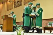 Dean Medical College AKU Dr Farhat Abbas awarding a student at AKU's 21st PGME graduation ceremony
