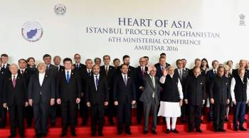 Sunday, Dec 4th, 2016 - Amritsar, India: Prime Minister Narendra Modi, along with Afghanistan's President Ashraf Ghani, Finance Minister Arun Jaitley, MoS for External Affairs V K Singh and other delegates, pose for a group photo before the inauguration of the 6th Heart of Asia Ministerial Conference. Mrs. Nurjehan Mawani, AKDN Resident Representative for Afghanistan, is seen standing at the back row, 5th person from the left. (PTI Photo by Kamal Kishore)