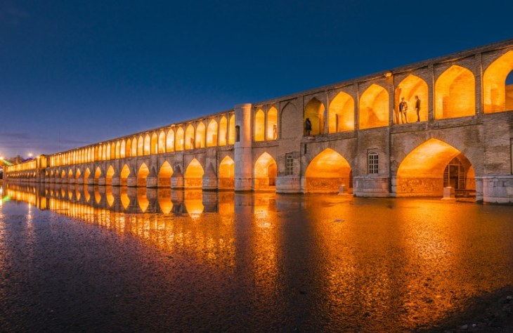 An image of Si-o-se Pol, one of eleven spectacular bridges in the city of Isfahan, Iran. Completed in 1602, the structure is nearly 1,000 feet long. (Image credit: Getty Images via Architectural Digest)