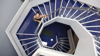 Yoga instructor YuMee Chung ready to demonstrate the 'Upward Spiral' yoga pose inspired by the twirling hexagonal staircase at the Aga Khan Museum. (Image credit: Anne-Marie Jackson via Toronto Star)