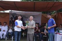 Receiving the winning trophy from cheif guest after winning the cricket tourament
