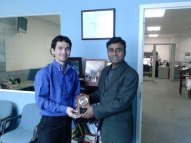 Receiving Token of Appreciation from Faiz Rehman (Cheif of the Urdu Service Voice of America) in Washington, DC.