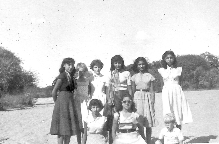 My sister (second from left) and me (bottom right) are pictured on a picnic with some of the girls from the school. We were dropped off from a lorry in a remote dry river bed for the picnic. Unfortunately the lorry did not return when arranged and after it got dark we lit fires to keep away the hyenas while we waited till we were eventually picked up.