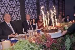Members of Hazar Imam's family applaud as the birthday cake is presented to Mawlana Hazar Imam. Photo: The Ismaili/Zahur Ramji