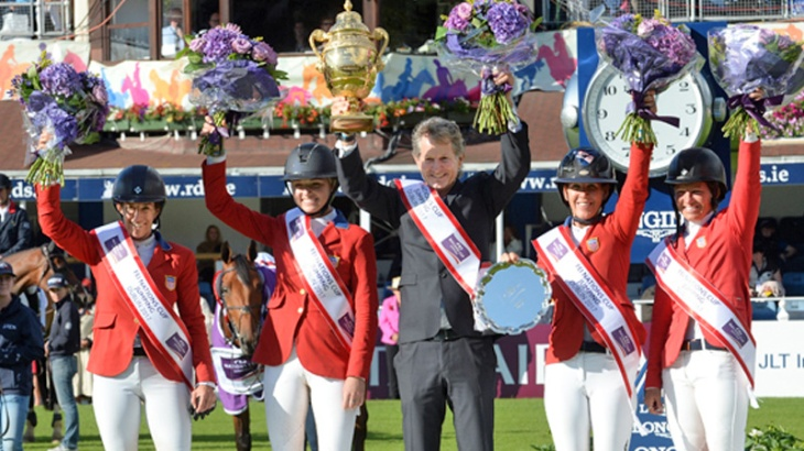 US team's chef d'equipe Robert Ridland holds the Aga Khan Cup. <br>From left to right: Laura Kraut, Lillie Keenan, chef d'equipe Robert Ridland, Lauren Hough, Beezie Madden triumphed in the FEI Nations Cup Dublin (image credit: Christoph Taniere)
