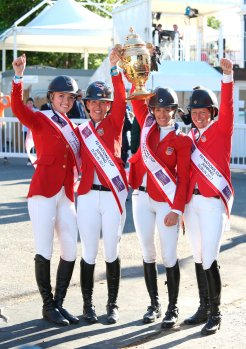 The all-female American team, from left to right: Lillie Keenan, Lauren Hough and Laura Kraut holding the Aga Khan Trophy, and Elizabeth Madden celebrate after winning the nations cup at the Dublin Horse Show in the RDS. (Image credit: Damien Eagers)