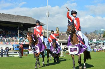 The US team celebrate winning the Aga Khan Trophy in the FEI Nations Cup, at the RDS in Dublin. (Image credit: Alan Betson via The Irish Times)