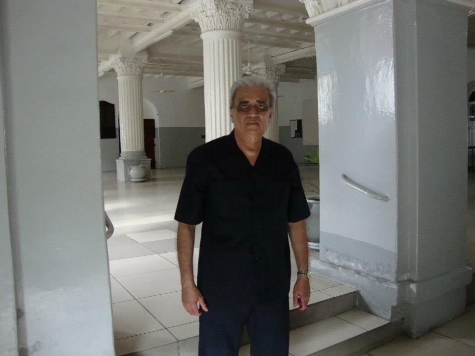 Kamruddin A. Rashid at the entrance of the social hall of Kuze Jamatkhana;