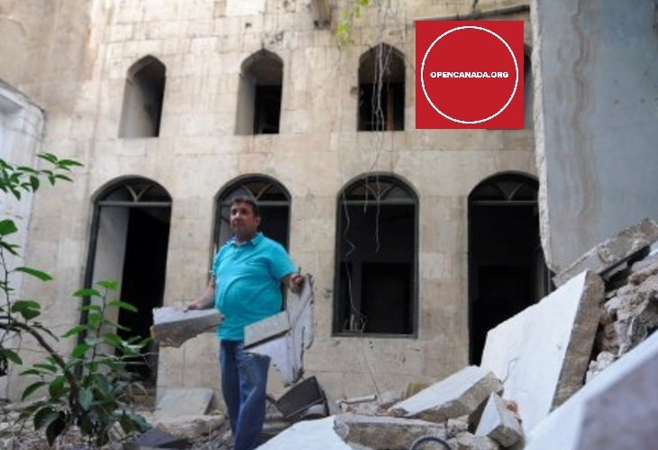 Mustafa al-Now is seen on debris in the old city of Aleppo, Syria July 16, 2017. (Image credit: REUTERS/Omar Sanadiki via Open Canada)
