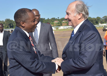 Attorney General William Byaruhanga receives the Aga Khan at Entebbe Airport yesterday evening. (Credit: William Rujuta)
