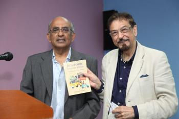 Dr. Mohamed Keshavjee (R) with Matthew Thomas (L)