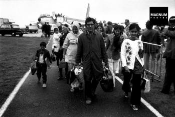 "Ugandan Asians arriving in Britain in 1972 following their expulsion by Idi Amin. This caused a ""psychosis of fear"" in the hearts of all Asians in East Africa leading to mnassive migration from other East African countries."