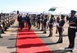 Mawlana Hazar Imam at Entebbe Airport as the Uganda Police Band plays the Nashid al Imamah and the Ugandan National Anthem. PHOTO: THE.ISMAILI / RAFIQ HAKIM