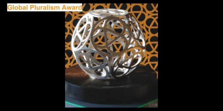 Inaugural Global Pluralism Award Sculpture and Artist
