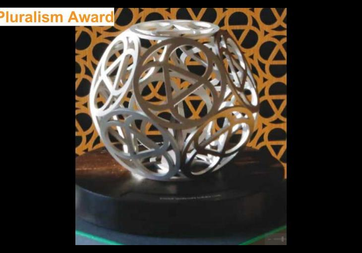 Inaugural Global Pluralism Award Sculpture and Artist
