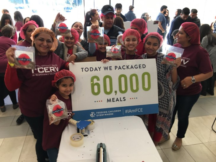 Over 500 Ismaili volunteers of all ages, assembled 80,000 meals for Atlanta's children and seniors in need