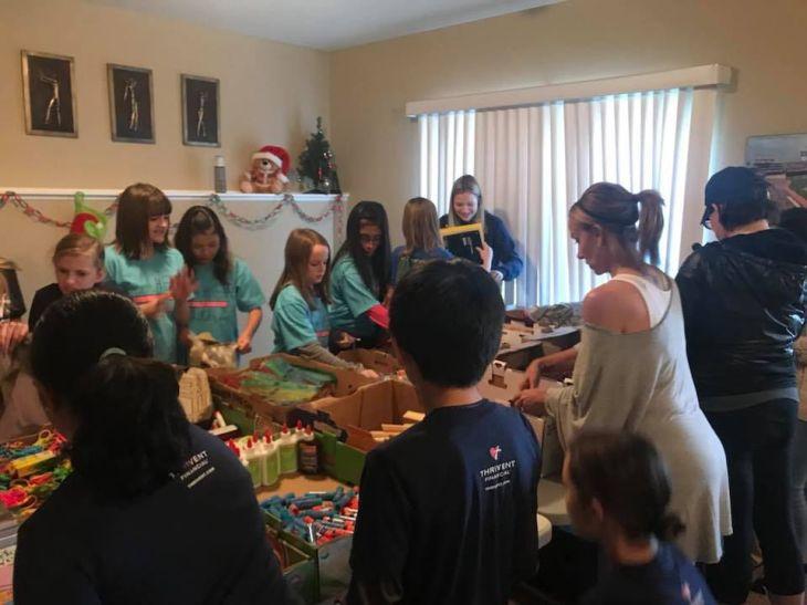 Local girl, volunteers pack bags for homeless children