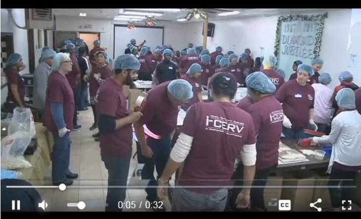 Ismaili Volunteers of Milwaukee, Wisconsin pack food to fight global hunger