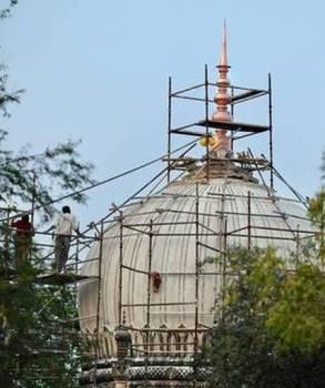 Finally, the finial gets fixed at Qutb Shahi tombs
