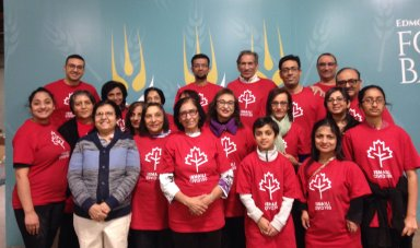 Ismaili Civic150 team packs food for Edmonton's Food Bank