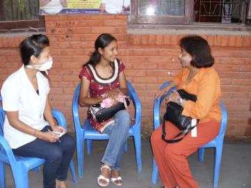 Discussing treatment for tuberculosis, with a patient at the German Nepal Tuberculosis Project, Kathmandu, Nepal in May, 2010.