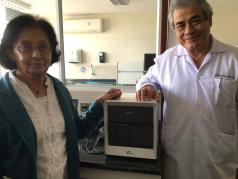 Handing over a Gene Expert machine, donated by her charity, World Without TB, to Dr. Eduardo Ticona at the Hospital Dos de Mayo, Lima , Peru in April, 2016.