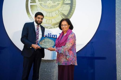 Iqbal Nasim, Chief Executive of National Zakat Foundation, presenting the Ibn Sina Award for Excellence in Health to Dr Amina Jindani, Honorary Senior Lecturer at St George's University of London on 23rd April, 2018. (Photograph by Abdul Datoo/The Muslim News)