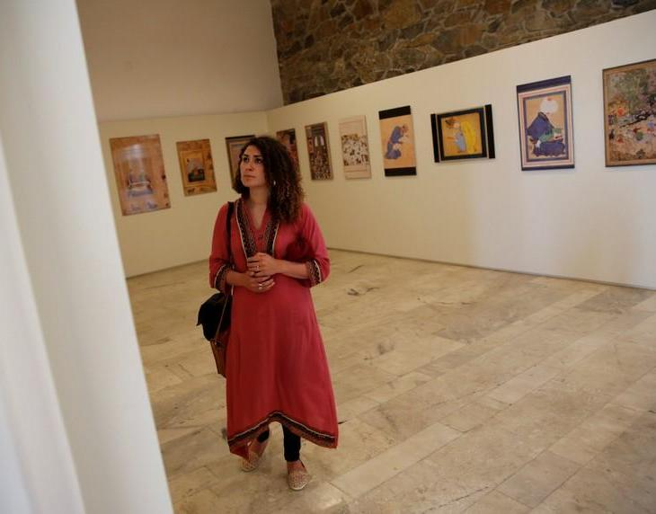 A woman looks at art exhibition at Babur Garden in Kabul, Afghanistan March 31, 2018. Picture taken March 31, 2018. REUTERS/Mohammad Ismail