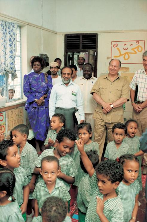 His Highness the Aga Khan visiting the Madrasa Resource Centre in Mombasa during his visit to Kenya (8-18 July 1991). Since 1986, the Madrasa Resource Centre in Kenya (MRCK) has trained over 500 Madrasa community pre-school teachers and has benefited nearly 7,800 students. MRCK has trained over 675 school management committee members (47 percent women) and more than 125 community resource team members (69 percent women). As of 2007, MRCK was working with over 75 community pre-schools throughout Kenya with nearly 2,900 students enrolled (48 percent girls). The programme's integrated curriculum has influenced national policy and practice, and has trained and supported over 2,000 pre-school teachers. - Photo credit: AKDN / Gary Otte