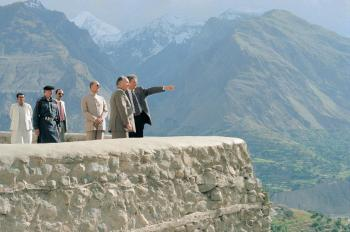 "His Highness the Aga Khan, admiring the breath-taking view from the Baltit Fort, northern Paksitan, in conversation with Stefano Bianco, Director of Historic Cities Support Programme, part of the Aga Khan Trust for Culture. Prince Amyn Aga Khan looks on. 1996. The conservation of the over 700 years old Baltit Fort, the pre-eminent landmark onument in Gilgit-Baltistan, and the rehabilitation of the historic core of the Karimabad village in the Hunza Valley, were the Aga Khan Historic Cities Programme first major interventions, completed in 1996. These projects, as well as others in neighbouring Baltistan, have won a number of prestigious prizes, including the UNESCO Asia-Pacific Heritage Awards for Cultural Heritage Conservation (every year between 2002 and 2013); a Time Magazine ""Best of Asia""; and a British Airways Tourism for Tomorrow Award. The Aga Khan Trust for Culture has completed dozens of other restoration projects in Baltistan and Hunza, but the area remains a treasure trove of scores of shrines, forts, mosques and other buildings of cultural and historical significance. - Photo credit: AKDN / Gary Otte"