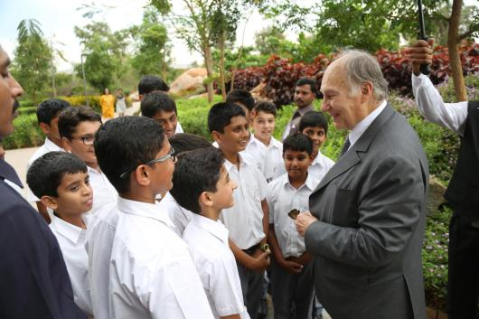 His Highness the Aga Khan meets a group of students on the campus of the Aga Khan Academy, Hyderabad, India, 10 April 2015. The Aga Khan Academies are a network of schools being established by His Highness the Aga Khan in countries accross South and Central Asia, Africa and the Middle East. - Photo credit: AKDN / Ahmed Charania