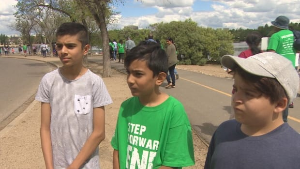 Lessons in compassion from children at world anti-poverty walk in Regina | CBC News
