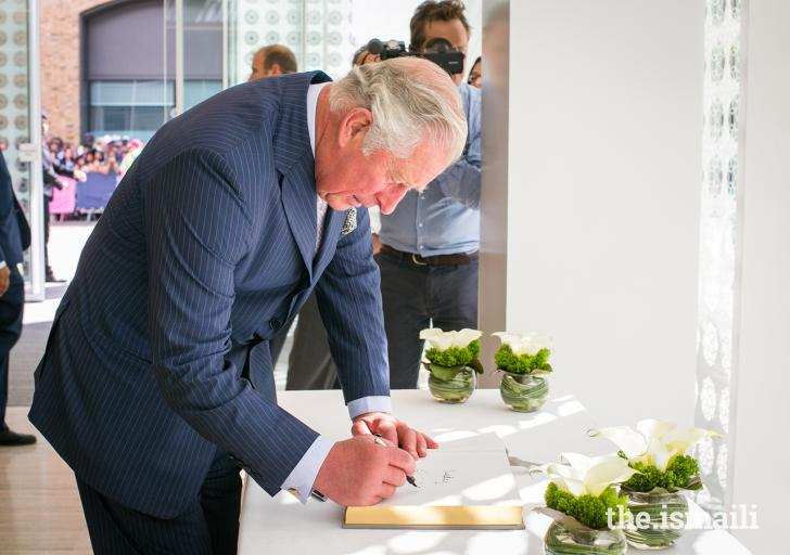 HRH The Prince of Wales signs the guest book during the inauguration of the Aga Khan Centre in London. 26 June 2018. Photo: The.Ismaili / ANYA CAMPBELL