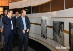 Prince Hussain and Prince Aly Muhammad admire a photograph of Mawlana Hazar Imam as a young boy, during their tour of the Rays of Light exhibition at the Diamond Jubilee Celebration in Lisbon.AZIZ AJANEY
