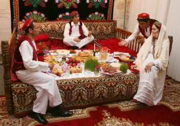 "A family illustrates a traditional Tajik Navroz meal according to the ""haft-shin"" and ""haft-sin"" traditions. MIKHAIL ROMANYUK - The Ismaili https://the.ismaili"